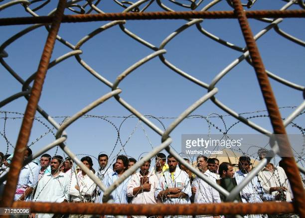 Iraqi prisoners wait to be released on June 23 2006 at Abu Ghraib prison west of Baghdad Iraq More than 500 Iraqi detainees were released from Abu...