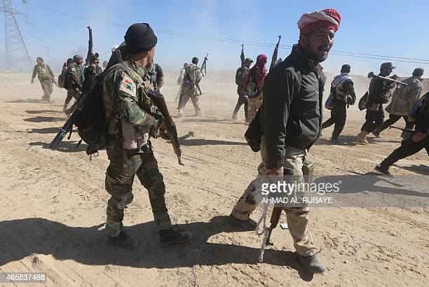 Iraqi pro-government fighters advance into Tikrit, 160 kms north of Baghdad, during a military operation to regain the city from jihadists from the...