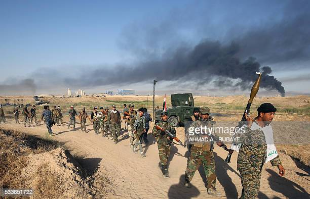Iraqi progovernment forces advance towards the city of Fallujah on May 23 as part of a major assault to retake the city from Islamic State group...