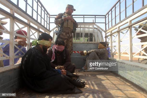 Iraqi progovernment forces detain men suspected of belonging to the Islamic State group during their offencive against the jihadists to recapture the...