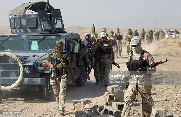 Iraqi progovernment forces gather as they advance towards the city of Fallujah on May 23 as part of a major assault to retake the city from Islamic...