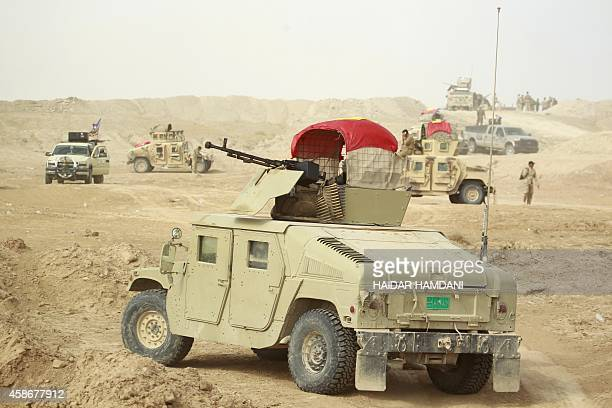 Iraqi progovernment forces hold a position near the town of Jurf alSakhr located between Baghdad and the shrine city of Karbala on October 30 after...