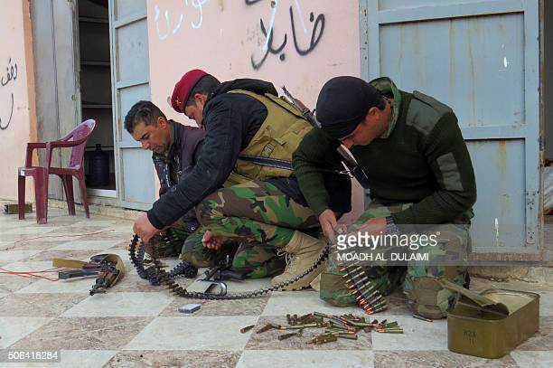 Iraqi progovernment forces prepare their ammunition as they continue to advance with the support of USled coalition air strikes towards Sajariya east...