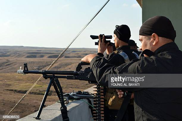 Iraqi progovernment forces take part in a major operation against Islamic State group fighters to retake the areas around the Hamrin dam in the...