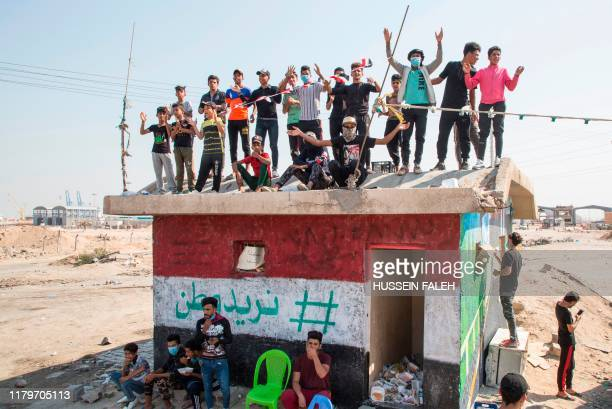 Iraqi protesters block the highway leading to Umm Qasr port during ongoing antigovernment demonstrations in southern Iraq on November 3 2019...