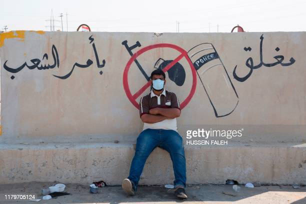 TOPSHOT Iraqi protesters block the highway leading to Umm Qasr port during ongoing antigovernment demonstrations in southern Iraq on November 3 2019...
