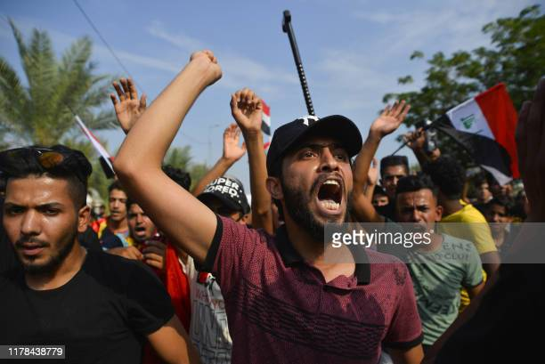 Iraqi protesters chant during an antigovernment demonstration outside the Najaf governorate headquarters in the central shrine city on October 27...