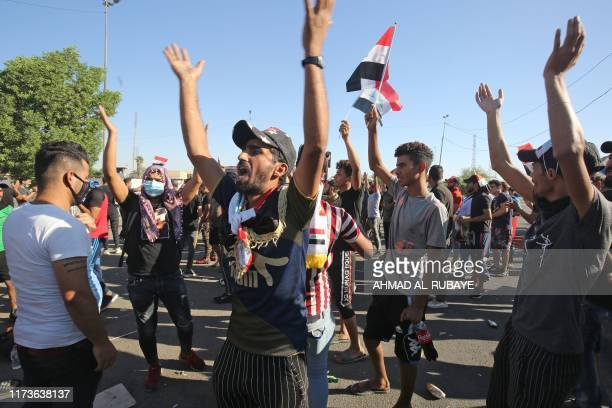 Iraqi protesters chant slogans during a demonstration against state corruption failing public services and unemployment in the Iraqi capital...