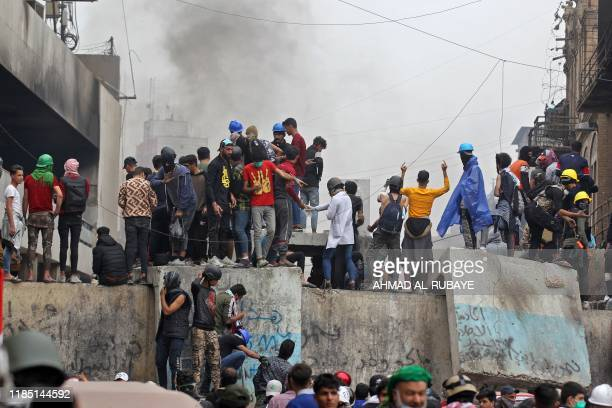 Iraqi protesters clash with Iraqi security forces in al-Rasheed Street during ongoing anti-government demonstrations against corruption on November...