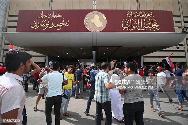 Iraqi protesters enter the parliament after breaking into Baghdad's heavily fortified 'Green Zone' on April 30 2016 A protest held outside the Green...