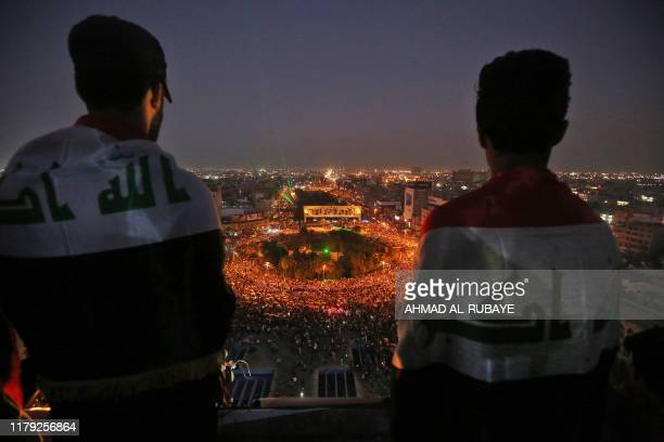 TOPSHOT Iraqi protesters gather at Tahrir square during ongoing antigovernment demonstrations in the capital Baghdad on October 31 2019 Iraq's...