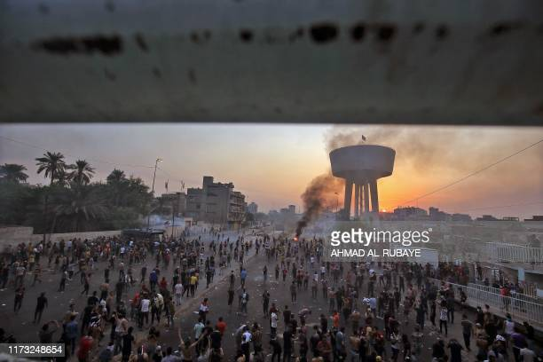 TOPSHOT Iraqi protesters gather during a demonstration against state corruption failing public services and unemployment at Tayaran square in Baghdad...