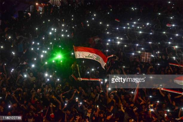 Iraqi protesters gather during a late anti-government demonstration in Nasiriyah, the capital of the southern province of Dhi Qar on November 4, 2019.