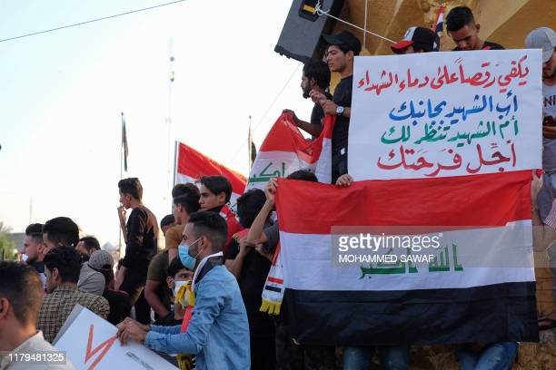 Iraqi protesters gather during ongoing anti-government demonstrations in the Shiite shrine city of Karbala, south of Iraq's capital Baghdad, on...