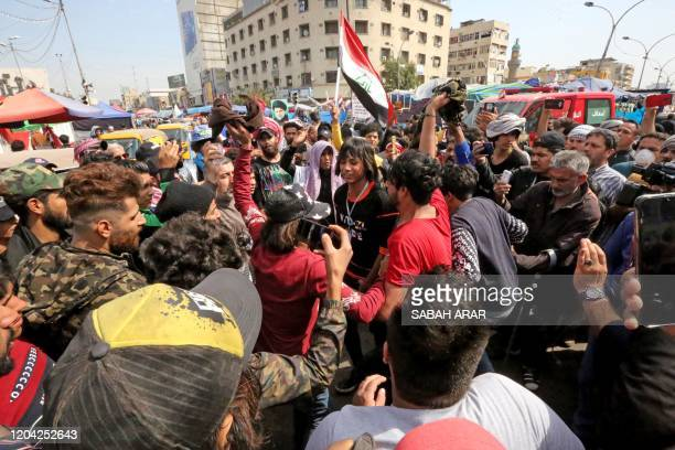 Iraqi protesters gather during ongoing antigovernment demonstrations in Baghdad's Tahrir Square on March 1 2020 Iraq's bitterly divided parliament...