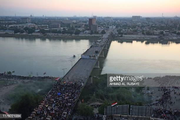 Iraqi protesters gather on alJumhuriya bridge which leads to the highsecurity Green Zone during ongoing antigovernment demonstrations in the capital...
