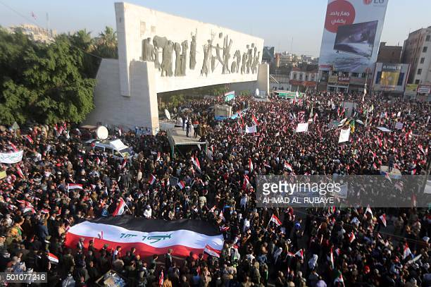 Iraqi protesters most of them members of Shiite paramilitary forces demonstration in Baghdad's Tahrir Square on December 12 to demand the withdrawal...
