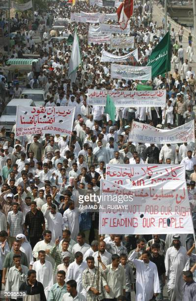 Iraqi protesters rally in the southern Iraqi city of Basra 15 June 2003 Some 12000 Iraqi Shiite Muslims marched in Basra to demand the withdrawal of...