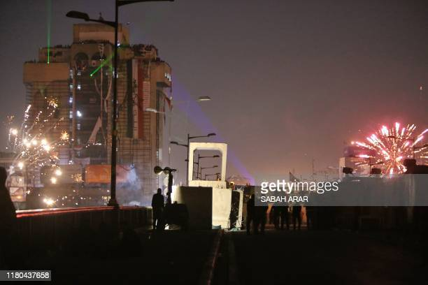 Iraqi protesters rally near alJumhuriya bridge which leads to the highsecurity Green Zone during ongoing antigovernment protests in the capital...