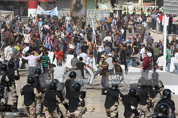 Iraqi protestors clash with Iraqi riot police on February 25 2011 at Baghdad's Tahrir square following a rally calling for improved public services...