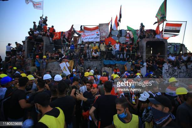 Iraqi protestors gather for ongoing anti-government demonstrations economic reforms and overhaul of the political system at Tahrir Square in Baghdad,...