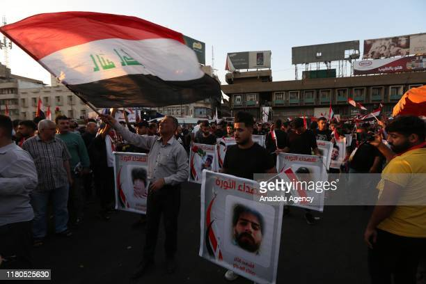 Iraqi protestors hold a commemoration ceremony for victims who lost their lives in protests as they gather at Tahrir Sqaure during ongoing...