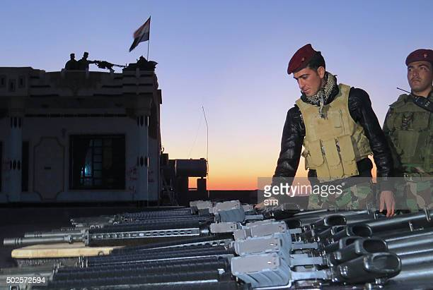 Iraqi rapid response forces inspect military equipment distributed by the Anbar police directorate in the southern Ramadi neighbourhood of Tash west...