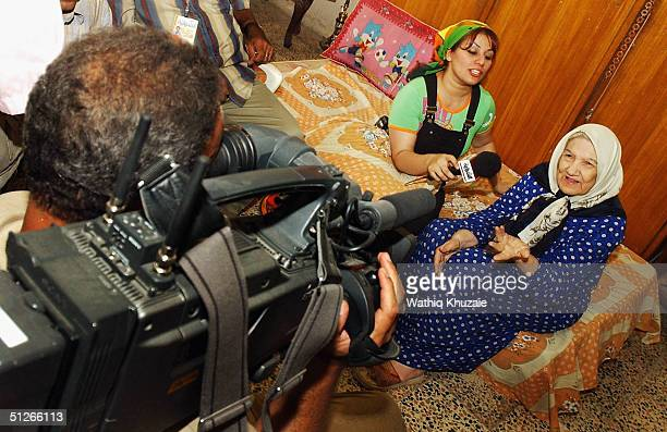 Iraqi reality TV show presenter Shaima Emad interviews Majida Rasheed whose house was damaged in one of the bombings which rocked Baghdad August 29...