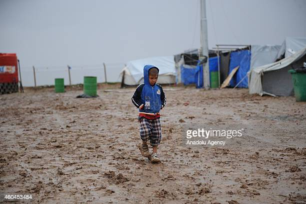 Iraqi refugee children fled their homes due to the violence of armed groups led by Islamic State of Iraq and Levant in Mosul and Tal Afar play after...