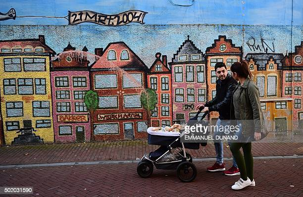 Iraqi refugees Ahmad and Alia with baby Adam take a walk in Leeuwarden The Netherlands on December 9 2015 After Ahmad and Alia survived a bomb attack...