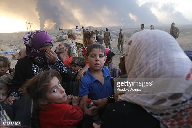 Iraqi refugees are seen after they have arrived at Al Qayyarah town secured by Iraqi Army in Mosul on October 18 2016 after they have fled from Daesh...