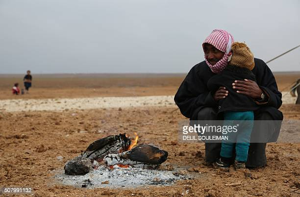 TOPSHOT Iraqi refugees mostly fleeing the northern city of Mosul now held by the Islamic State group stand at a new camp on the outskirts of the...