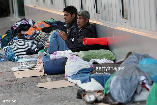 Iraqi refugees wait outside the LaGeSo State Office for Health and Social Services the office for registering migrants on September 26 2015 in Berlin...