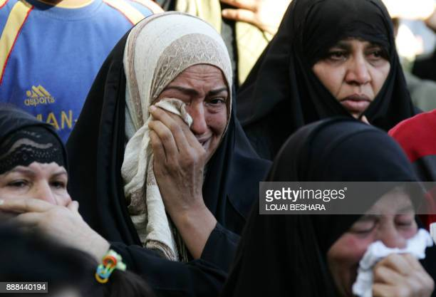 Iraqi refugees weep while listening to a speech by Iraqi Parliament Speaker Mahmud Mashhadani at the Sayyida Zeinab district, south of the Syrian...