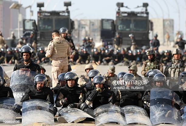 Iraqi riot police block the streets in the capital Baghdad on March 4 as protesters head on foot into the centre after officials imposed vehicle bans...