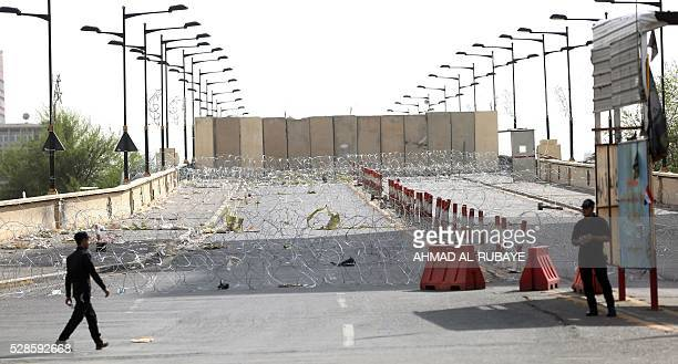 Iraqi riot police stand guard at the Jumhuriyah Bridge a route leading from Tahrir Square to the Green Zone on May 6 a week after Moqtada alSadr...