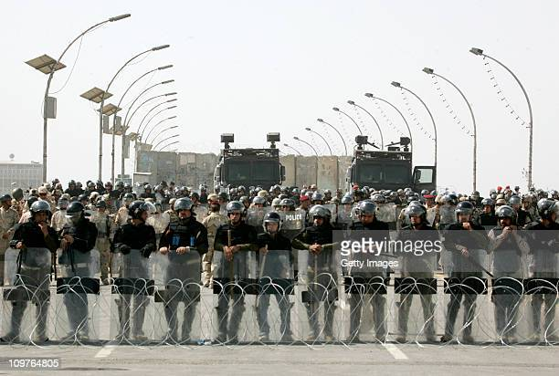 Iraqi riot policemen close alJumhoriya Bridge leading to the heavily fortified Green Zone area during antigovernment demonstration on March 4 2011...