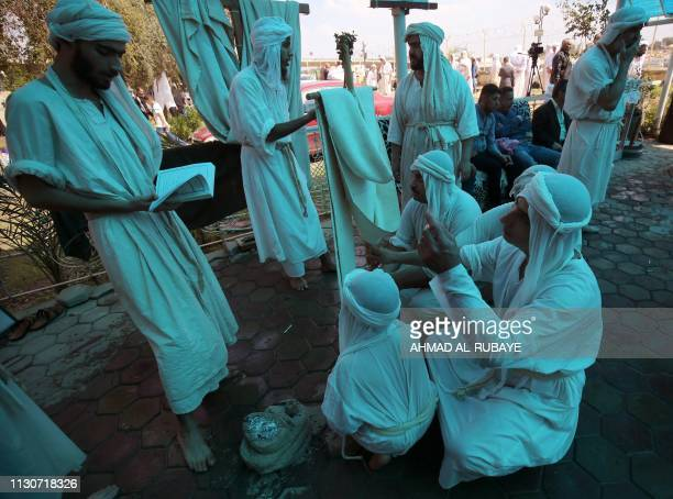 Iraqi Sabeans followers of a preChristian religion which considers the prophet Abraham as one of the founders of their faith pray in Baghdad on March...