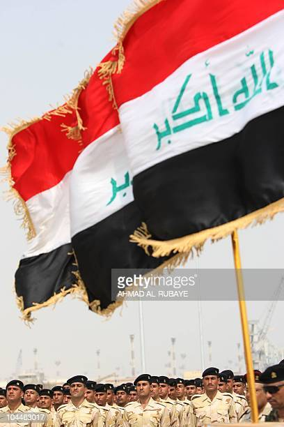 Iraqi sailors stand to attention during their graduation ceremony as Iraq inaugurates the first in a fleet of new USbuilt patrol boats on September...