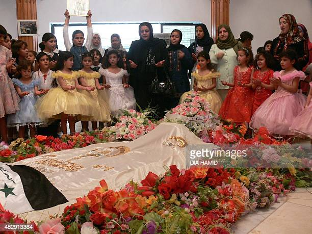Iraqi schoolgirl pray over the tomb of Saddam Hussein in the village of Awja on April 28 2008 Sunni Arab supporters of Saddam Hussein marked the...
