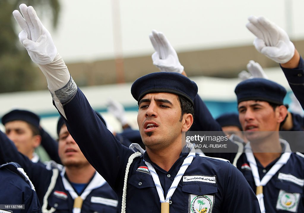 Iraqi scouts, whose organization follows the Lebanese Hezbollah Shiite Muslim political party, march during a celebration in Baghdad on February 9, 2013, to commemorate the withdrawal of US troops' from Iraq in December 2011, ending nearly nine years of the mainly US led occupation of Iraq.