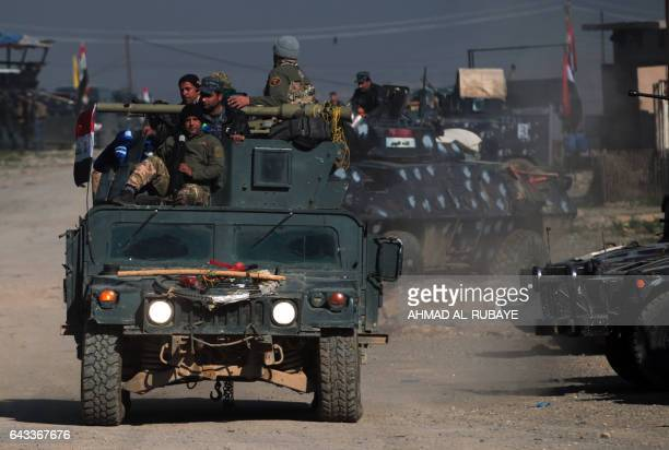 Iraqi security forces advance in the village of al-Buseif, south of Mosul, during an offensive to retake the western side of the city from Islamic...