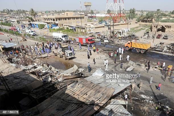 Iraqi security forces and onlookers gather at the site of a massive suicide car bomb attack carried out the previous day by the Islamic State group...