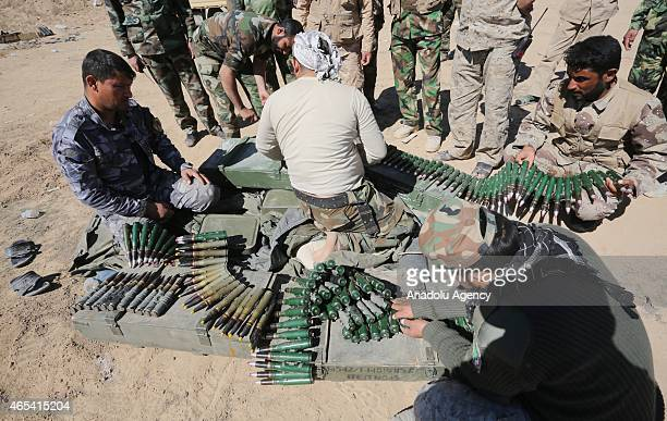 Iraqi security forces and Shia militias stage attacks against Daesh members with heavy and light weapons to recapture the Tikrit City Iraq on March...