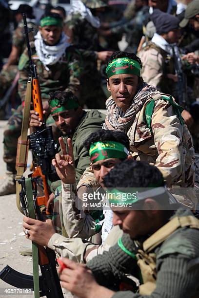 Iraqi security forces and volunteer Shiite fighters known as the Popular Mobilisation units gather in the city of Samarra on March 5 ahead of moving...