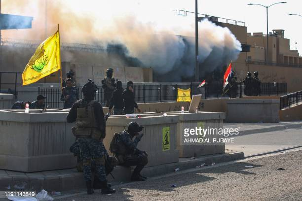 Iraqi security forces are deployed in front of the US embassy in the capital Baghdad, after an order from the Hashed al-Shaabi paramilitary force to...