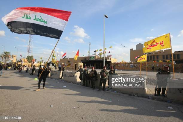 TOPSHOT Iraqi security forces are deployed in front of the US embassy in the capital Baghdad after an order from the Hashed alShaabi paramilitary...