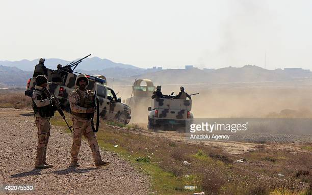 Iraqi security forces are seen during a military operation launched by the Iraqi army to retake positions held by Islamic State of Iraq and the...