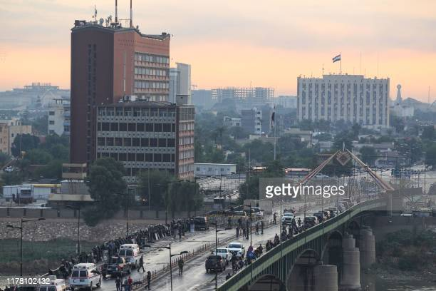 Iraqi security forces block AlJumhuriya Bridge which leads to the Green Zone during an antigovernment demonstration in the Iraqi capital Baghdad on...