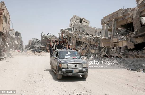 Iraqi security forces celebrate after Mosul completely freed from Daesh in Mosul Syria on July 9 2017 Mosul was captured by Daesh along vast swathes...